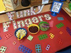 Jack and the Beanstalk funky fingers. Using tweezers to put beans in the numicon shapes.