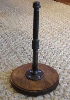 """Amazing Industrial / Rustic / Primitive Paper Towel Holder. The towel holder is made from 1/2"""" Black steel pipe. The towel holder stands about 13"""" high and looks amazing on any kitchen counter."""