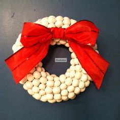 Painted Acorn Holiday Wreath by Buy This, Not That- Acorns go from fall to winter and become a beautiful holiday accessory when painted a milky white in this cute wreath.