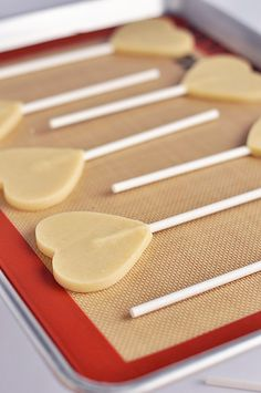 Good tips for making sugar cookie pops Perfect Sugar Cookie via Sweetapolita Cookie Pops, Cookie Crisp, Royal Icing Cookies, Cupcake Cookies, Sugar Cookies, Cookie Favors, Baby Cookies, Flower Cookies, Heart Cookies