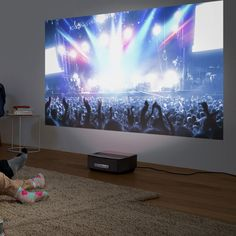 Bring the big screen experience to your living room without the need for ceiling mounts or additional speakers and peripherals thanks to the Screeneo HDP1590 smart LED projector. Just place the Screeneo a few centimetres from the wall and enjoy images from 50 inch to 100 inch. Screeneo projectors have everything you need in one box, including integrated speakers, LED lighting technology and a host of connection options such as HDMI, Bluetooth, Wi-Fi, Miracast and DLNA, as well as the option…