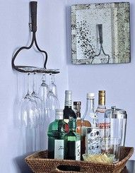 Repurposing is GREAT!  Use an old rake head to make a rustic glass holder