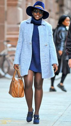 Lupita Nyong'o in a blue mini dress, baby blue coat, brogues and a wide-brimmed hat - click through for more fall fashion inspiration