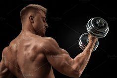 Bodybuilder doing exercises by Usmanov Stock Photography on @creativemarket