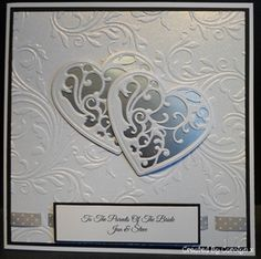 Use Cricut to cut out hearts. Use pop-up stickie on patterned paper. Punch holes for ribbon.