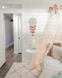 Love this cute and easy-to-recreate farmhouse girls bedroom. that is wallpaper shiplap, wow! Twinkle Lights Bedroom, Bedroom Decor Lights, Boho Bedroom Decor, Farmhouse Bedroom Decor, Bedroom Decor On A Budget, Bedroom Decor For Teen Girls, Apartment Bedroom Decor, Bedroom Ideas, Room Wallpaper