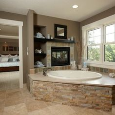 Like: Stone (maybe a different type), surrounding the edge of the tub, fireplace, shelf/storage