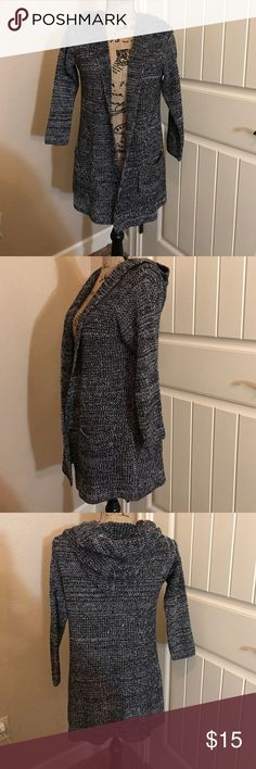 Black & White Cardigan Comfortable and cute Cardigan. Sleeves are actually a 3/4 sleeve. Never been worn but tags removed. It was dry cleaned and bagged even though not worn. Has a hood attached and two pockets on each side in front. Size is small and fits true to size. XS could also pass for it. No specific brand. No rips, stains, tears, or picks as it's not been worn. Sweaters Cardigans