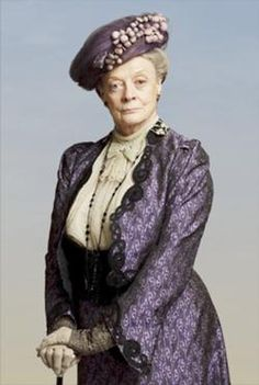 2/21/14 11:31p Downton Abbey Violet Crawley, Dowager Countess of Grantham (b. 1845) is the widow of the late Patrick Crawley, 4th Earl of Grantham, mother of Robert Crawley, Earl of Grantham and the Lady Rosamund. mother-in-law of Cora Crawley, Countess of Grantham, grandmother of her three granddaughters Lady Mary Crawley, Lady Edith Crawley and Lady Sybil Branson nee Crawley.