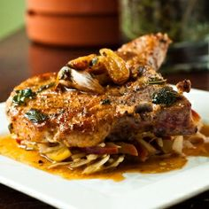 Pan seared pork chops basted in sage and garlic butter. Served with a tender apple coleslaw!