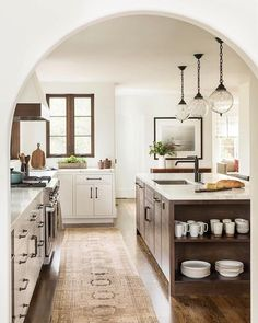 White kitchen with warm wood and glass globe pendants