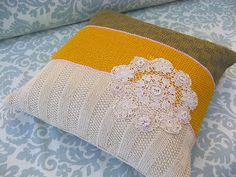 Love, love, love the color and detail on this one. Knitted pillow cover with a crocheted doily.