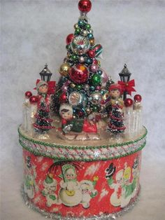 Decorated box with bottle brush tree and figures