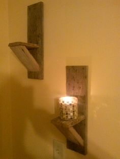 """Sconces made from reclaim barn wood. Coming to etsy $25.00 each or $45.00 for the pair, candle not included. 16 1/2"""" tall x 4 1/2"""" wide x 6"""" deep"""