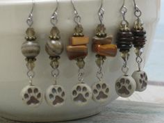 Paw Print Animal Rescue Earrings with Natural by SeagrassJewelry, $15.00  $5 from each pair will be donated directly to animal rescue  Follow us on FB:  http://on.fb.me/1aCiJEJ