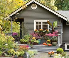 Perfect late summer transition into fall landscaping idea. Bonus, love the home exterior.
