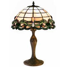 Add some class to your bedroom or guest room with this glass Tiffany style table lamp. The large rounded base will minimize any tipping, and the small size would lend an elegant compliment to a small desk, side table or bedroom dresser.