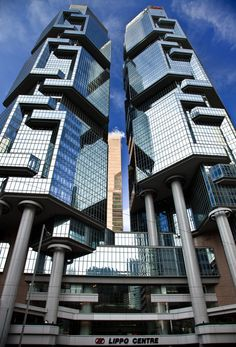 The Lippo Centre is a pair of twin office towers in Hong Kong, previously known as the Bond Center Hong Kong Architecture, Creative Architecture, Architecture Art Design, Facade Design, Futuristic Architecture, Facade Architecture, Beautiful Architecture, New York City Buildings, Future Buildings