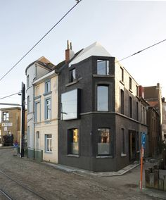 Built by GRAUX & BAEYENS architecten in Ghent, Belgium with date 2011. Images by Luc Roymans . House G-S in Ghent, Belgium   This 19th century corner house is located at the Muide waterfront area with a unique vi...