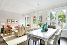 the best paint colour for a ceiling can be the same as the trim as show in this open layout dining room and living room by cardea homes