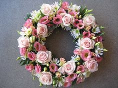 A feminine Passionflower sympathy wreath in pinks with roses and lisianthus - see more at www.passion-flower.net