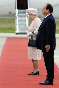 Queen Elizabeth II and French President Francois Hollande review French troops during a departure ceremony at the Villacoublay airport on 07.06.2014 in Paris, France.