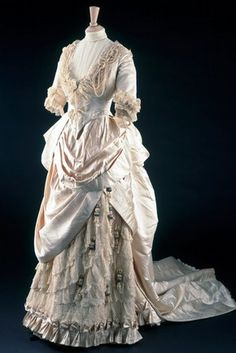 The wedding dress of May Primrose became part of the Textile and Dress Collection of the Victoria and Albert Museum in 1990 1. It was made in 1885 for her marriage to Henry Littledale. The couple then moved to India and May Littledale died a year later in a riding accident. Her belongings were packed together and shipped back to England. The wedding dress was never worn by anyone else and remained in the family, totally unaltered.