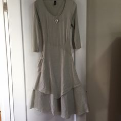 "Very sophisticated yet casual dress. Very sophisticated yet casual dress.  It comes to about mid calf as a 5'6"" size 6 and looks amazing!  Light neutral color. Dresses Midi"