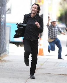 Keanu Reeves stealing a camera from the paparazzi