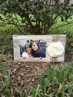 Barn wood picture frame holds a 3 1/2 x 5 to a 4 x 6 photo and is embellished with a fabric rolled rosette and jute. $25.00