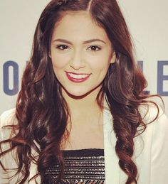 522b6eec99c Bethany Mota Long Partially Braided - Bethany Mota looked adorable with her  partially braided corkscrew curls during Jingle Ball.