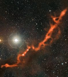 """""""Dark markings of the sky"""".. A new image from the APEX (Atacama Pathfinder Experiment) telescope in Chile shows a sinuous filament of cosmic dust more than ten light-years long. In it, newborn stars are hidden, and dense clouds of gas are on the verge of collapsing to form yet more stars. It is one of the regions of star formation closest to us. The cosmic dust grains are so cold that observations at wavelengths of around one millimetre, such as these made with the LABOCA camera on APEX"""
