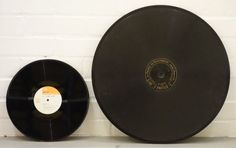100-year-old, 20-inch Pathe Concert disc next to 12-inch LP. It was used in an early jukebox, played at 120rpm