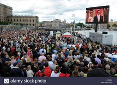 Spectators watch the wedding of Swedish Crown Princess Victoria and Prince Daniel of Sweden, the Duke of Vastergotland, on a large screen in front of the Royal Palace in Stockholm, Sweden, 19 June 2010. Photo: CARSTEN REHDER Stock Photo