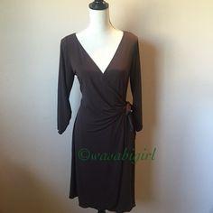 Dark Chocolate Brown Wrap Dress Classic wrap dress by Studio M. Tie belt passes through the inside. 95% polyester/ 5% spandex offers elegant drape. Runs true to size. No Trades Studio M Dresses