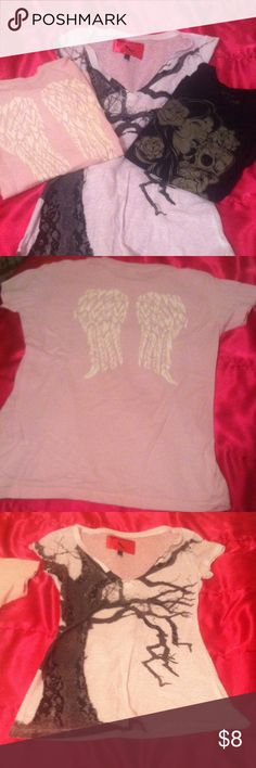 """T shirt bundle! Lot of three cute t shirts :) one Is baby pink with white wings on back of tee (front is plain) the white tee is v neck (size medium) and has a really pretty lace and """"wet look"""" image of a tree on it. The third is a black tee with a girl licking a decorated skull. (I loved this shirt!!) the pink one has never been worn and the other two have been used but are in good shape :) I wish these still fit me! Hot Topic Tops Tees - Short Sleeve"""