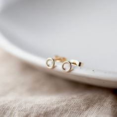 These lovely circle studs are so simple and stylish. Minimalist stud earrings Small enough to wear every day but just different enough to make you feel special! The important info: Made from: Recycled 9ct GoldSize: These tiny studs measure 5mmFinish: PolishedTime to make: 2-3-daysPackaging: Recyclable These earrings are handmade by me in my own little workshop in Northamptonshire. Beautifully gift-wrapped I want you to have a little smile on your face when the postman delivers your parcel… Arrow Earrings, Stud Earrings, How To Clean Silver, Cleaning Silver Jewelry, Summer Jewelry, Minimalist Earrings, Studs, Workshop, Handmade Jewelry