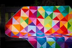 Love the colors of this quilt.  Grab the 'Postcard from Sweden' Quilt pattern for free.