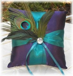 Peacock Ring Bearer Pillow...YES!!  First one I've seen with pretty much perfect colors :)