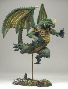 """McFarlane Toys Dragons Series 8 - 6"""" Berserker Dragon by McFarlane Toys. $12.95. Base measures 5 1/8 inches by 31/4 inches.. Figure hovers 21/2 inches above custom base, highest point of left wing reaching 91/4 inches, 111/2 inches from nose to tip of tail.. Limited Production. Clamshell packaging. Articulated at neck and shoulders.. From the Manufacturer                Events in the dragon kingdom are escalating, setting the stage for an all-new adventure. McFarl..."""