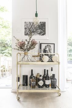 Bar cart design with flowers, and gold accents.