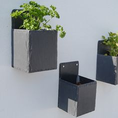 """I recall my dad making some interesting and attractive planters from old roof tiles. He drilled two holes near the corner on each edge of one and on three edges of four more. (Make sure you drill at a low speed else they're likely to crack). He then simply wired the five pieces together (the one drilled on 4 sides on the botom) to make planters. The rust from the wire he'd used looked quite pretty, rather surprisingly, and the gaps around the edges of the tiles made for excellent drainage."""