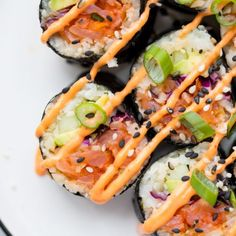 This Whole30 sushi spicy salmon roll is as legit as it gets but with none of the grains or sugar! Made with seasoned cauliflower rice, this Whole30 sushi spicy salmon roll uses easy-to-find smoked salmon, lots of veggies, and is low carb and keto friendly.