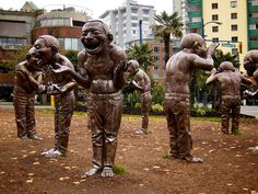'A-Maze-Ing Laughter' - sculpture by Yue Minjun;  English Bay, Vancouver, British Columbia, Canada  14 bronze laughing statues in different poses;  photo by Paul Robert Lloyd, via Flickr