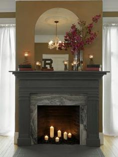 DIY Network has instructions on how to cover an old fireplace surround with marble and create a new mantel using an old door frame and molding. Diy Fireplace Mantel, Fake Fireplace, Fireplace Surrounds, Fireplace Design, Fireplace Ideas, Mantel Ideas, Farmhouse Fireplace, Faux Mantle, Fireplace Frame