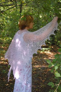 The shawl is worked from center back to the bottom edge.  free pattern