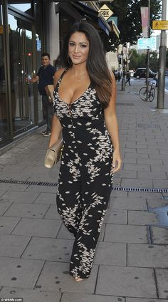 Busty babe: Casey Batchelor showed off her perky assets in a plunging jumpsuit...