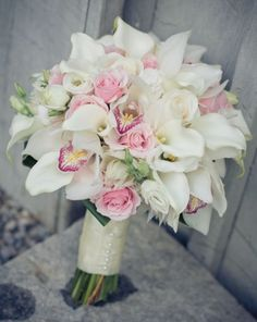 Using calla lillies and putting smaller, colored flowers in it!! So gorgeous! #white #orchid #bouquet
