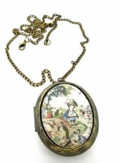 Alice in Wonderland Scene Locket Necklace Fallen Saint £9.99, http://www.amazon.co.uk/dp/B006424F2C/ref=cm_sw_r_pi_dp_612ftb1P5VCXT