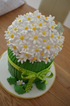 Daisy cake, I think it's made using the cupcake pan.